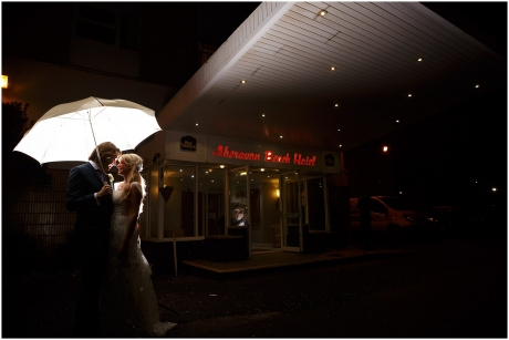 Aberration Beach Hotel Entrance at night under an umbrella